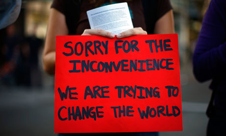 A demonstrator in Oakland holds a sign on 2 November, 2011. Photograph: Eric Thayer/Getty Images