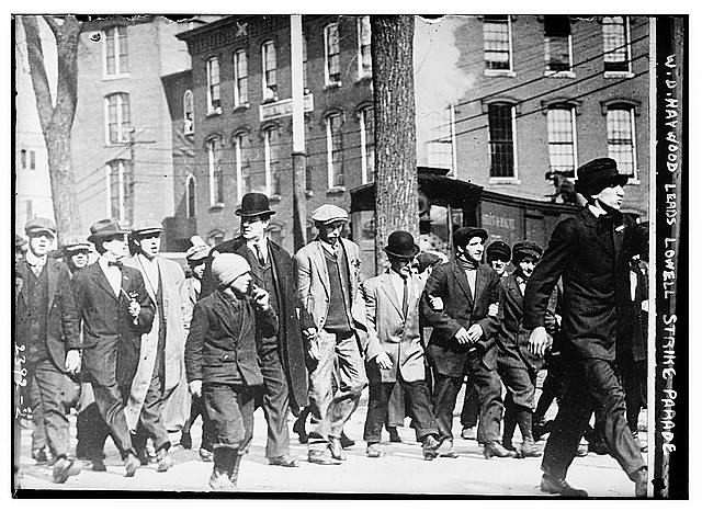 William Dudley (Big Bill) Haywood, US labour movement leader, marching with strikers in Lowell, Massachusetts, circa 1912.