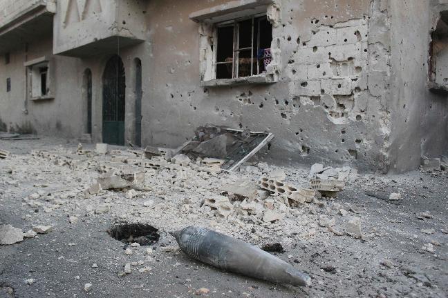 An ordnance shell is seen near a damaged building in Jubar near Homs July 14, 2012. Picture taken July 14, 2012. REUTERS/Shaam News Network/Handout