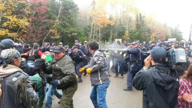 "An image from the October 2013 RCMP raid on the Mi'kmaq resistance to the colonial plunder and destruction of shale ""fracking"" in New Brunswick."